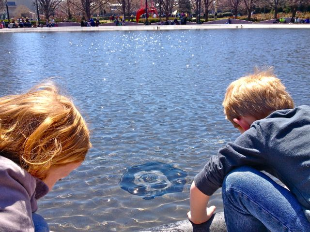 Kids in reflecting pond