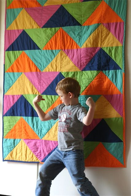 Cal in front of Triangle Quilt